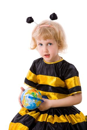 Little Girl wearing bee costume holding globe isolated on white photo