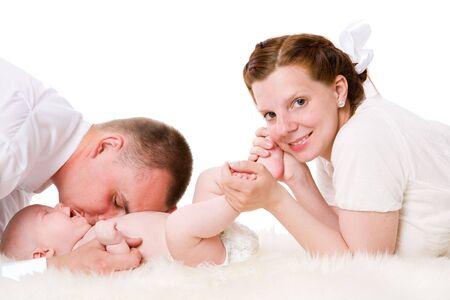 Happy Family enjoying baby together isolated on white photo