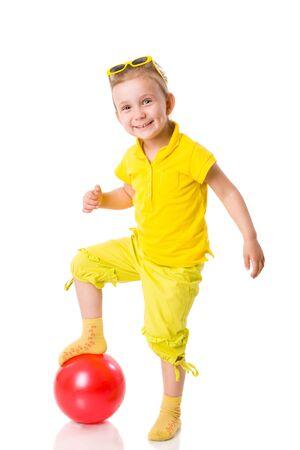 Summer girl wearing sunglasses holding ball isolated on white Stock Photo - 5115779