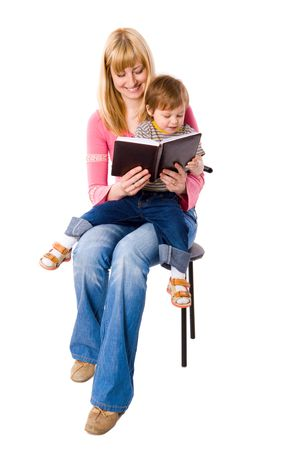Mother reading book to her son isolated on white Stock Photo - 5115774