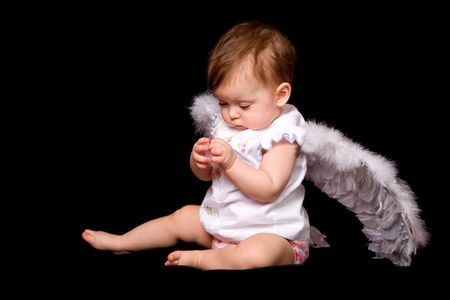 six month baby angel over black background photo