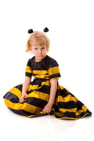 Upset Bee girl wearing halloween costume isolated on white photo