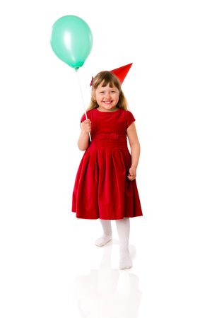Birthday girl wearing cap holding balloon isolated on white photo