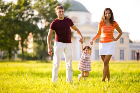 family house: Happy Family in front of house outdoors