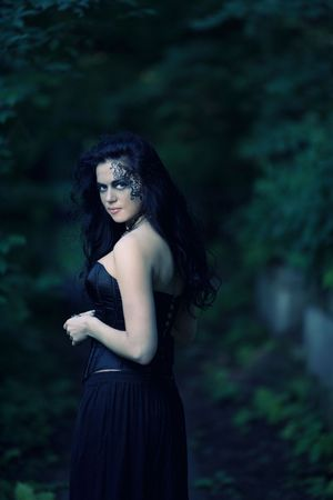 Young beautiful demonic female creaturewalking through the night Stock Photo - 5504355