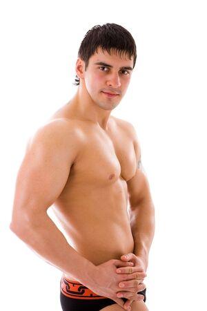 hombre deportista: Hombre joven atleta mirando aisladas en blanco Foto de archivo