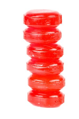 lozenge: Stack of sweet transparent red shugar candies isolated on white Stock Photo