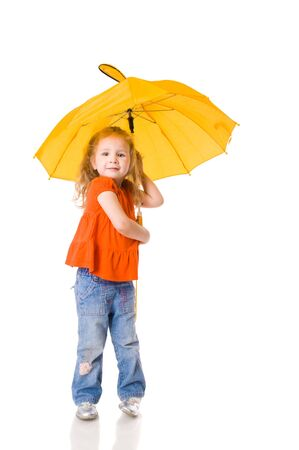 umbrella rain: Little Girl standing with umbrella isolated on white Stock Photo