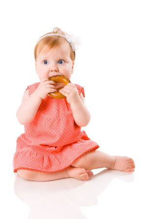 One year Baby eating tasty cookie isolated on white photo