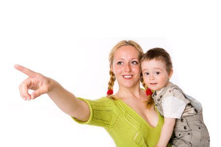 Mother holding son pointing somewhere isolated on white Stock Photo - 6035823