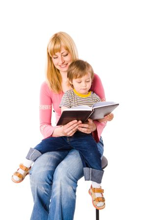 Mother reading book to her son isolated on white Stock Photo - 6035821