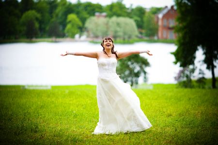 Happy Bride looking up dancing and laughing photo