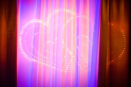 Hearts Background made of lighting under red velvet curtains photo