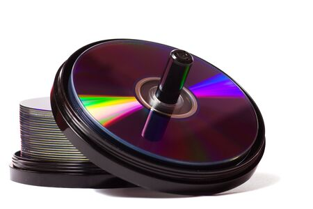 dvdr: Two Stacks of empty dvd-r disks isolated on white background Stock Photo