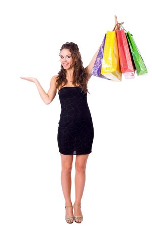 Young Woman shopping holding bags isolated on white Stock Photo - 6083004