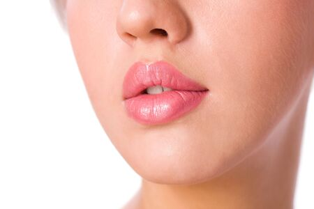 Young womans Lips and nose close up isolated on white