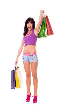 Young Woman shopping holding bags isolated on white Stock Photo - 6083473