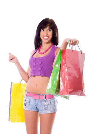 Young Woman shopping holding bags isolated on white Stock Photo - 6082987