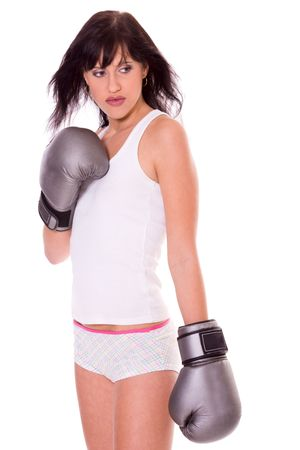 violence in sports: Young woman wearing boxing gloves isolated on white Stock Photo
