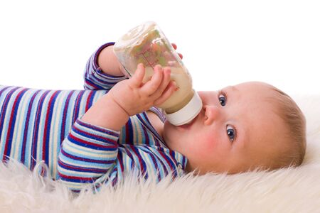 Adorable Seven month Baby eating from bottle  photo