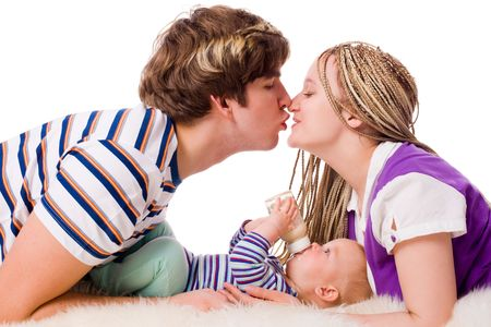Happy Young Family with six month baby together isolated Stock Photo - 6083459