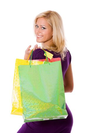 Young Woman shopping holding bags isolated on white photo