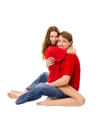Young Couple staring at you isolated on white photo