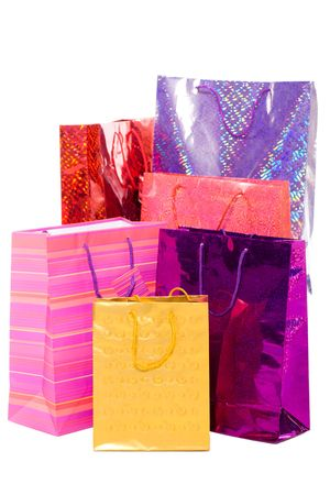 Bunch colorful paper bags for gifts isolated on white photo