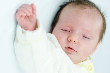 Newborn baby less than month age sleeping photo