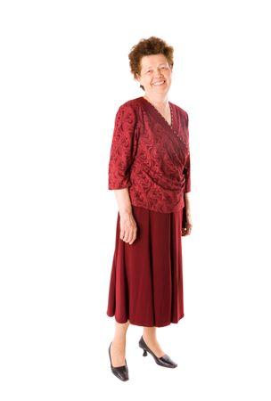 full red: Felice vecchia signora in rossi vestiti in piedi isolated on white