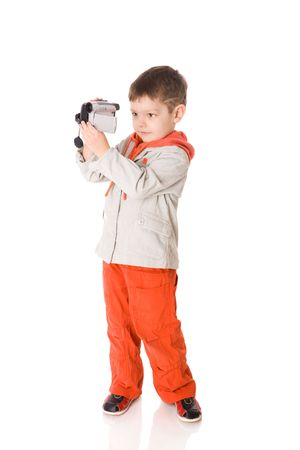 Little boy shooting film with digital camera isolated photo