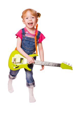 Little Girl playing guitar and singing isolated on white photo