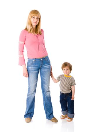 interested baby: Mother and son wearing jeans standing isolated on white