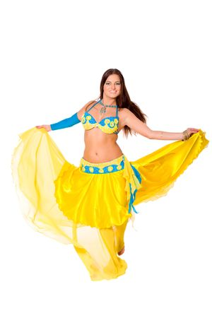 Beautiful young brunette belly dance woman isolated on white photo