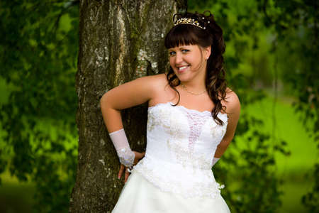 Happy Bride smiling near summer tree outdoors  Stock Photo - 6155357