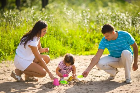 Happy Family playing with kid together summer outdoors Stock Photo - 6155514