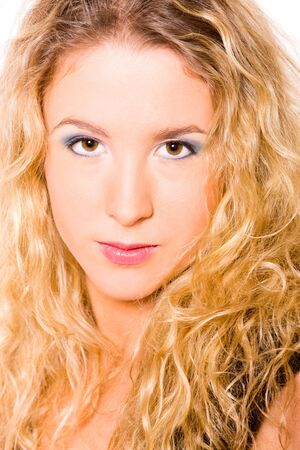 Closeup portrait of young blond woman with curly hair  photo