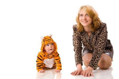Mother with half year daughter baby wearing tiger costume isolated photo