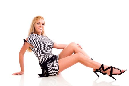 Young Beautiful Blond Woman sitting isolated on white photo