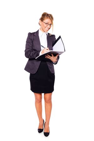 Businesswoman writing holding folder isolated on white photo
