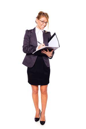 Businesswoman writing holding folder isolated on white photo