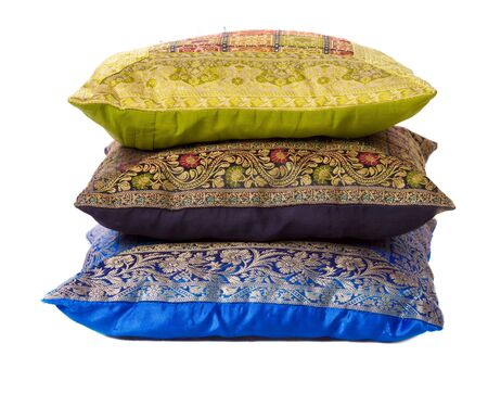 cushioning: Three soft pillows lying one above another isolated on white