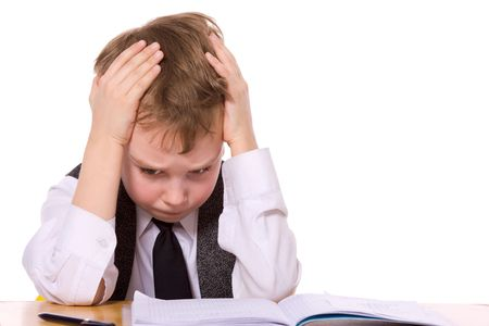 cry: Upset schoolboy doing homework isolated on white