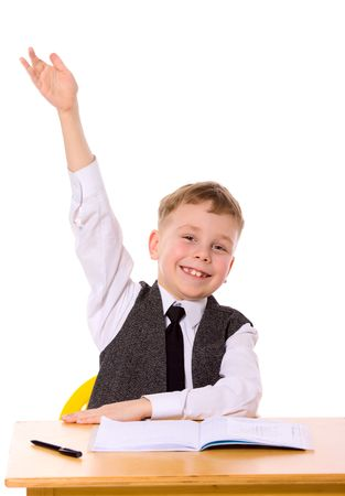 raising hand: Cheerful Schoolboy ready to answer question isolated