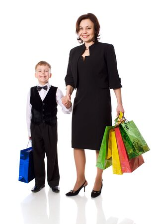 Mother and son went shopping holding colorful bags isolated photo