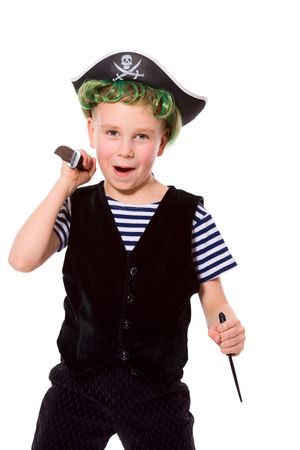 dressing up costume: Boy wearing pirate costume holding knifes isolated on white