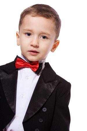 Little Boy wearing tuxedo portrait isolated on white photo