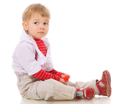 two years: Two years Boy sitting sad isolated on white