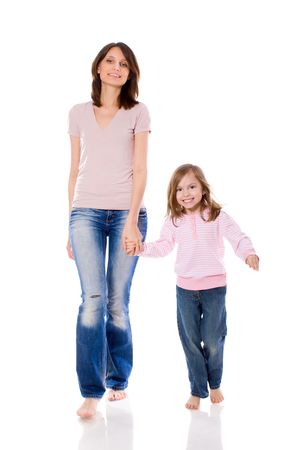 Mother and daughter smiling walking together isolated Stock Photo - 7045403