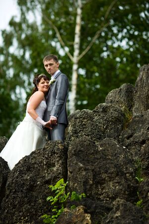 Bride and groom posing summer park outdoors photo